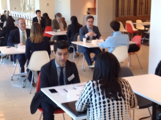 Mike Vasquez '12, Chad Guo'13, Bijan Madhani '13 mentor current students at a speed-networking session.